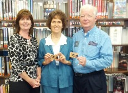 Library Director Mary McCasland, Buena Park Library, issues us our new Gold Cards