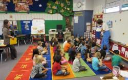 K & 1st grade class listening to Otis